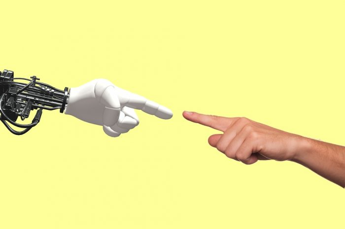 Robot-Human-Hand-Public-Domain-700x465