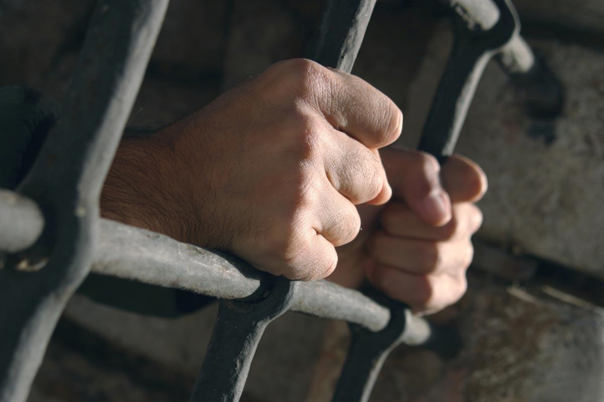 Jail-Prison-Prisoner-Crime-Bars-Hands