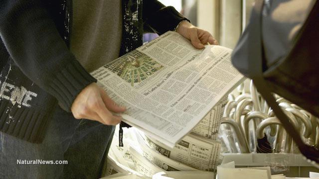 Holding-Newspaper